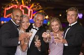 Group Of Adults In Casino With Champagne