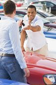 pic of car key  - Man shopping for a car - JPG