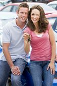 image of car key  - Young couple shopping for a car - JPG