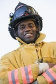Firefighter Standing In Uniform