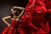 Woman In Red Dress Dancing With Flying Fabric