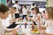 stock photo of tweeny  - Students having lunch in dining hall - JPG