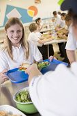 stock photo of school lunch  - Student having lunch in dining hall - JPG