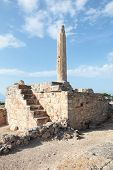 The one ancient column still standing at the 6th Century BC temple to the sun god Apollo on the isla