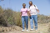 Senior Couple On A Walking Trail