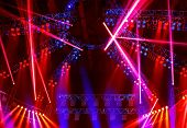 Image of nightclub lights, red spotlight beam in the dance club, Christmas celebration, clubbing life, colorful festive rays on the stage on concert, New Year party, laser performance, holiday concept