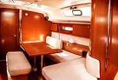 Image of luxury ship interior, comfortable sailboat cabin, expensive wooden design and soft white so