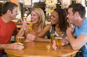 stock photo of hair integrations  - Two couples having beer together - JPG