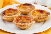 stock photo of pasteis  - Pasteis de nata on the white plate - JPG