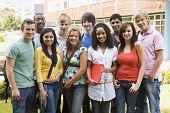 pic of late 20s  - Group of students outdoors looking at camera smiling - JPG