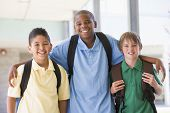 foto of tweenie  - Three students standing outside school together smiling  - JPG