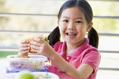 foto of school lunch  - Student outdoors eating lunch  - JPG