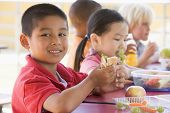 stock photo of fruits vegetables  - Students outdoors eating lunch  - JPG