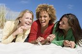 stock photo of hair integrations  - Three women posing on a sand hill - JPG