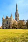 Salisbury Cathedral Front View And Park On Sunny Day, South England