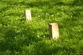stock photo of game_over  - Swedish lawn game Kubb where the object is to knock over wooden blocks by throwing wooden sticks at them - JPG