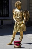 Living Statue - A Man In The Image Of Cupid