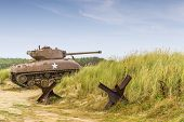 picture of ww2  - a ww2 sherman tank on utah beach normandy - JPG
