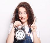 Young fun woman with alarmclock