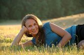 Teenage Girl Lying In Grass