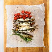 Smoked whitefish with tomatoes and greens