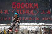 Kid In Front Off Roadsign, Tibet