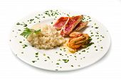 foto of mullet  - white dish with rice red mullet fillets and seafood - JPG