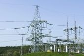 image of transmission lines  - Towers of high voltage transmission lines and other electrical engineering equipment - JPG