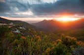 stock photo of fynbos  - View from mountains over mountains with fynbos and sunset