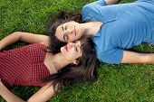 Young Couple Taking A Nap On Green Grass
