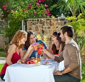 Couples Enjoying A Healthy Outdoor Lunch