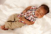 Closeup of 6 Month Old Little Baby African American Boy Sleeping