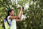 picture of pre-adolescent girl  - Girl Photographing in Forest - JPG