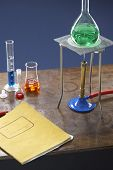 Bunsen burner tripod flask and test tubes in science laboratory