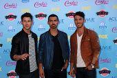 LOS ANGELES - AUG 11:  Nick Jonas, Joe Jonas, Kevin Jonas at the 2013 Teen Choice Awards at the Gibs