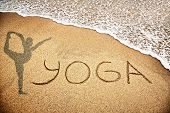 image of natarajasana  - Yoga title with man doing yoga on the sand beach near the ocean - JPG