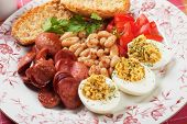 Deviled eggs with beans and sausage, rich and tasty breakfast plate