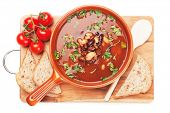 Thick kidney bean soup with bread and cherry tomato, isolated on white background