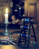 Sewing by candlelight with antique cotton reels - vintage duo tone effect