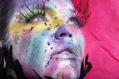 Beautiful Woman With Extreme Spattered Make Up on the Face