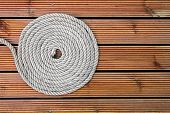 picture of coiled  - closeup of rope on wooden yacht deck