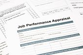pic of performance evaluation  - closeup job performance appraisal and paperwork evaluation and assessment concept for human resource business - JPG