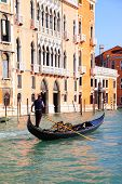 VENICE, ITALY - OCTOBER 02, 2013: Gondolier drives his gondola on Grand Canal in Venice