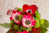 stock photo of windflowers  - bouquet of  red anemone flowers on wooden table close up - JPG
