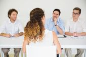 stock photo of conduction  - Panel of interviewers conducting job interview with female candidate - JPG
