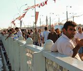 People On Galata Bridge In Istanbul