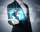 business and future technology concept - closeup of businessmans hand showing earth globe