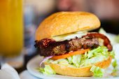 stock photo of burger  - Close up of delicious fresh burger with cheese and bacon - JPG