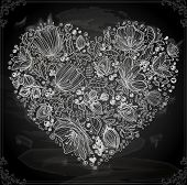 Stylish floral heart, hand drawn retro flowers. Chalk style, Chalkboard background.