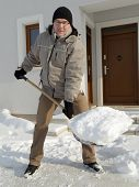 stock photo of plowing  - Man clearing path to his house of snow with shovel after heavy snowing - JPG